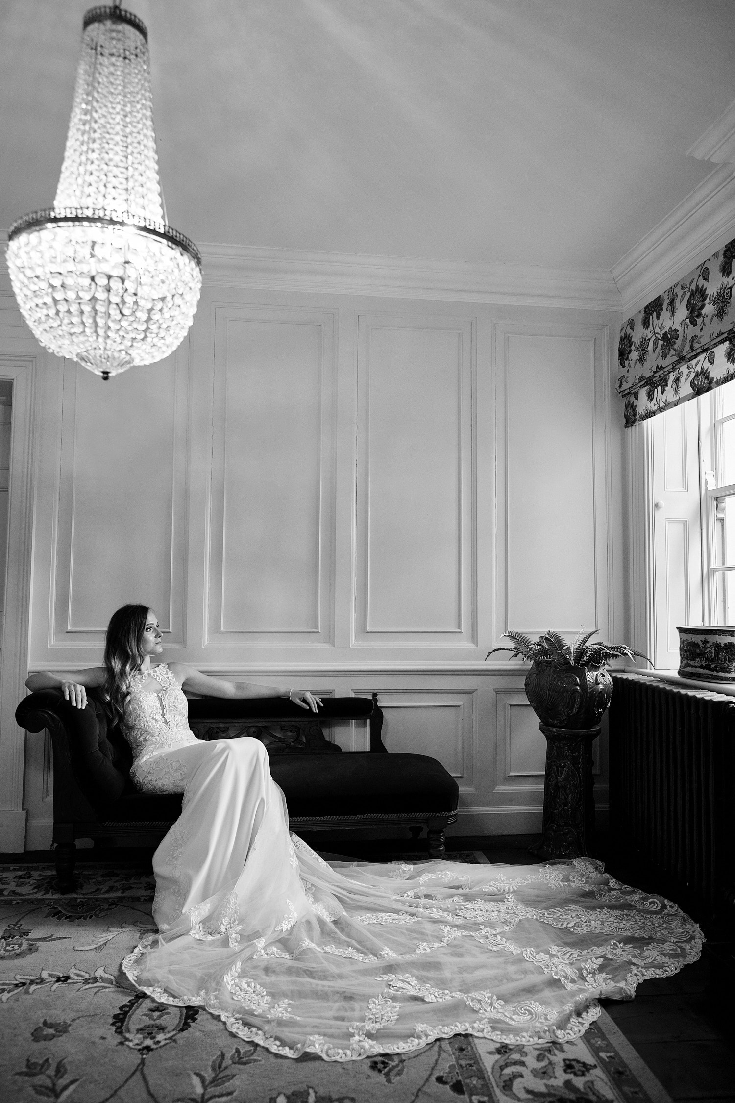 A bride relaxes in the entrance to The Elm Tree Wedding venue in Lincolnshire