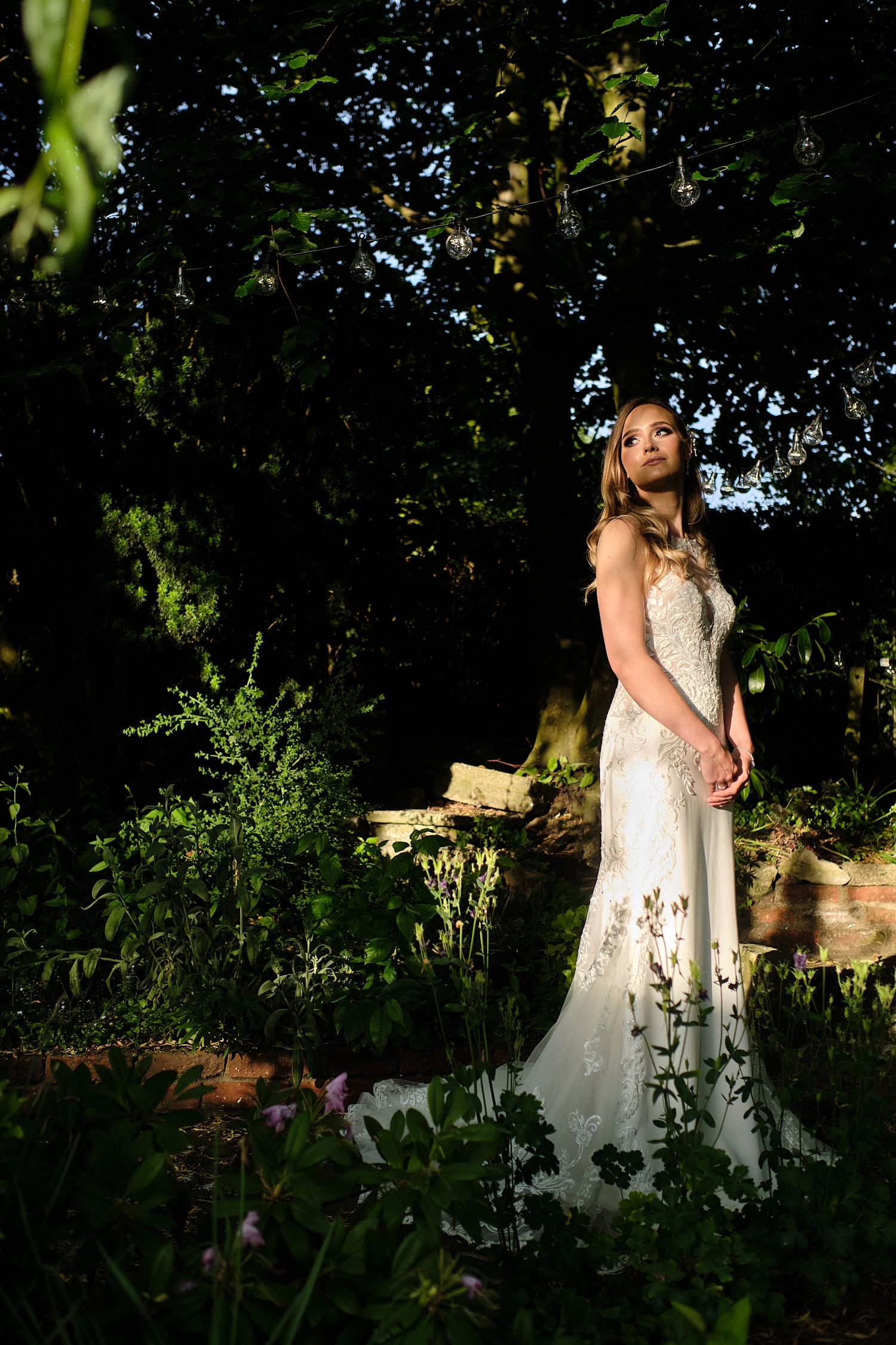 A bride poses in the garden of the Elm Tree Hundelby